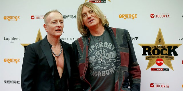 Def Leppard lead singer Joe Elliott (R) and lead guitarist Phil Collen pose on the red carpet at the 2016 Classic Rock Roll of Honour awards in Tokyo, Japan, November 11, 2016.