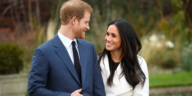 Britain's Prince Harry poses with Meghan Markle in the Sunken Garden of Kensington Palace, London, Britain, November 27, 2017. REUTERS/Toby Melville - RC11339802A0