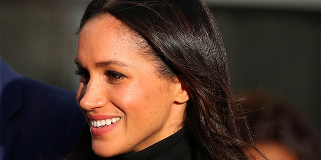 Meghan Markle leaves after visiting a school with her fiancee Britain's Prince Harry in Nottingham, December 1, 2017.