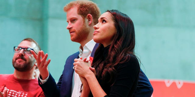 Meghan Markle with Prince Harry after their engagement announcement.