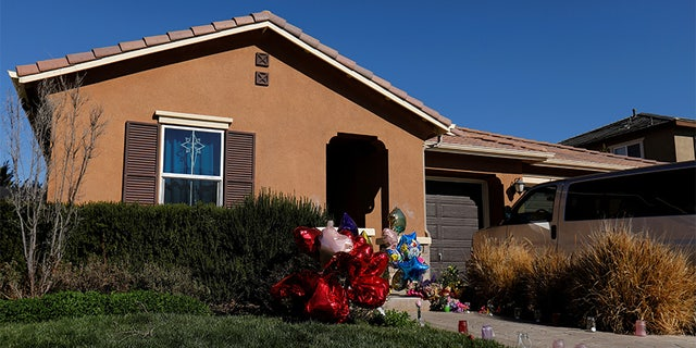 Balloons, stuffed animals and flowers are seen in the front yard of the home of David Allen and Louise Anna Turpin in Perris, California, U.S.,January 24, 2018.