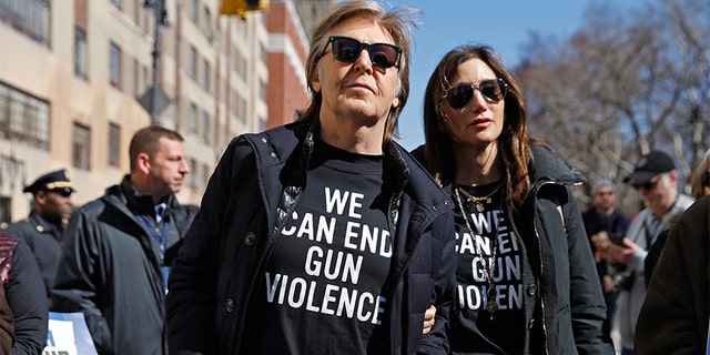 """Former Beatle Sir Paul McCartney joins the rally during a """"March For Our Lives"""" demonstration demanding gun control in New York City, U.S. March 24, 2018."""