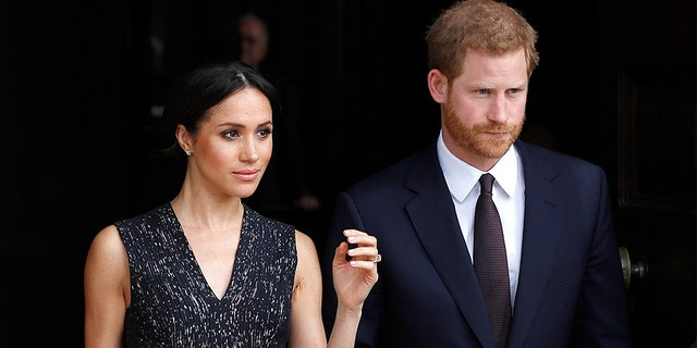 Britain's Prince Harry and his fiancee Meghan Markle leave a service at St Martin-in-The Fields to mark 25 years since Stephen Lawrence was killed in a racially motivated attack, in London, Britain, April 23, 2018.
