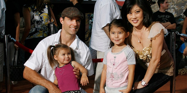 "Olympic figure skating champion Kristi Yamaguchi (R) poses with husband Bret Hedican (L) and daughters Emma (2nd L) and Keara at the world premiere of Disney-Pixar's film ""Wall-E"" in Los Angeles, California June 21, 2008."