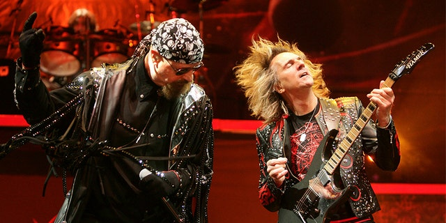 Singer Rob Halford (L) and guitarist Glenn Tipton of British metal band Judas Priest perform on stage at Globen Arena in Stockholm on Feb. 28, 2009.