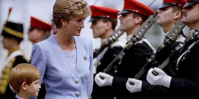 Princess Diana with Prince Harry.