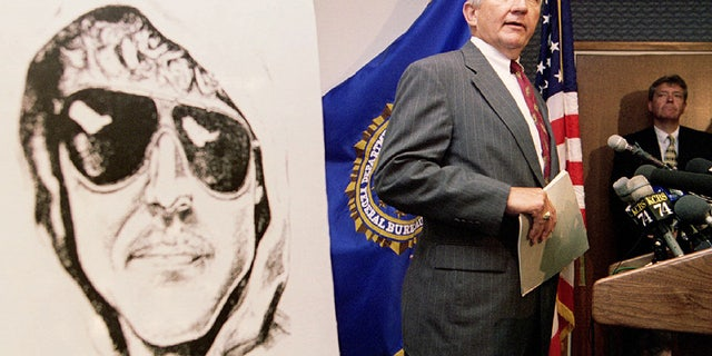 FBI Special Agent in Charge Jim Freeman confirms to reporters the authenticity of the most-recent communication from the notorious Unabomber, seen in a composite photo at left, during a press conference in San Francisco, June 28. The Unabomber has threatened to bomb an airliner leaving Los Angeles in the next six days - RTXFWC0
