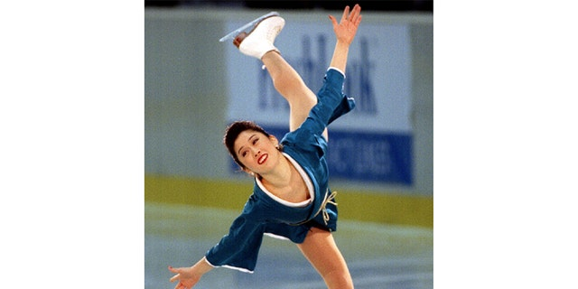 1992 world champion Kristi Yamaguchi of the United States performs in the women's singles in the 10th International Professional Figure Skating Championship in Tokyo.