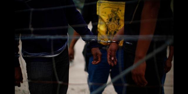 March 29, 2013: People are taken into custody by U.S. Border Patrol near Falfurrias, Texas.