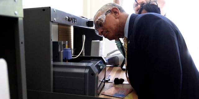 NASA Administrator Charles Bolden looks over a 3D printer during a tour of the Ames Research Center at Moffett Field in Mountain View, California May 24, 2013.