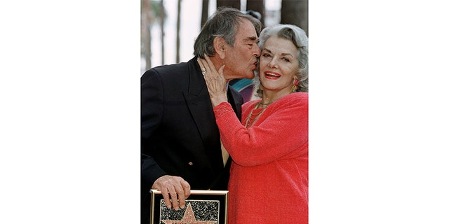 Actor Stuart Whitman gives a kiss to his neighbor, actress Jane Russell, during the ceremony where he received his star on the Walk of Fame in Hollywood February 1, 1998.