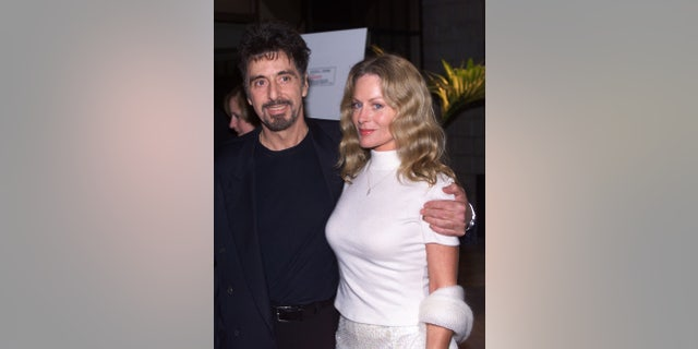 """In this 1999 photo, actor Al Pacino, (L) star of the new film """"The Insider"""", poses with girlfriend Beverly D'Angelo at the film's premiere in Beverly Hills."""