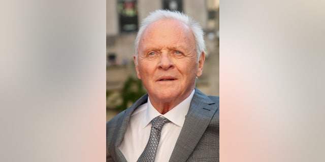 Anthony Hopkins' Malibu home is still standing after the California wildfires destroyed his neighbor's home.