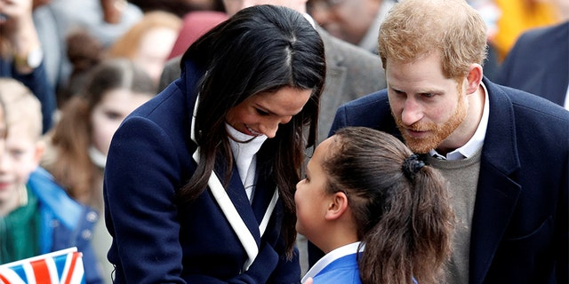 Britain's Prince Harry and his fiancee Meghan Markle meet local school children during a walkabout on a visit to Birmingham, Britain, March 8, 2018.