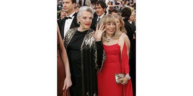 Holllywood legend, actress Jane Russell (L), arrives with a unknown guest at the 78th annual Academy Awards at the Kodak Theatre in Hollywood, California March 5, 2006.