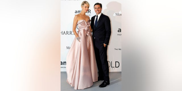 Model Karolina Kurkova (L) and her husband Archie Drury pose during a photocall as they arrive to attend the amfAR's Cinema Against AIDS 2015.