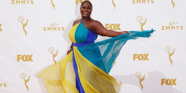 """Actress Danielle Brooks, who is best known for portraying Taystee on Netflix's """"Orange Is The New Black,"""" poses as she arrives at the 67th Primetime Emmy Awards in Los Angeles, California September 20, 2015."""