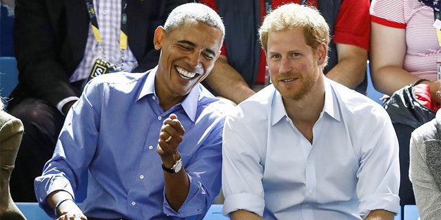 Britain's Prince Harry (R) and former U.S. President Barack Obama watch a wheelchair basketball event during the Invictus Games in Toronto, Ontario, Canada September 29, 2017.