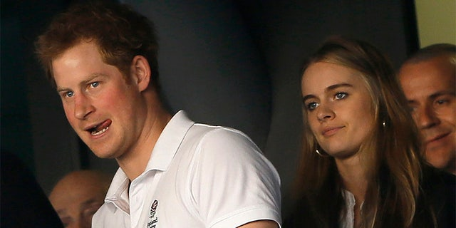 Prince Harry attends WE Day about in 2013 with then-girlfriend, British model/actress Cressida Bonas.