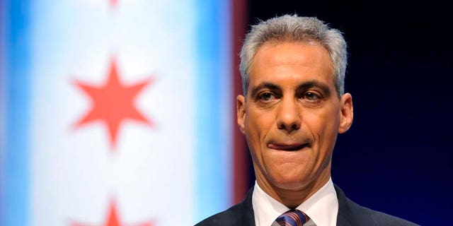 Chicago mayoral candidate Rahm Emanuel prepares to debate his opponents Gery Chico, Carol Moseley Braun and Miguel del Valle at the Oriental Theater in Chicago Thursday, Feb. 17, 2011. (AP Photo/Brian Kersey)