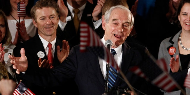 FILE: Jan. 3, 2012: Former GOP presidential candidate Texas Rep. Ron Paul and son Kentucky GOP Sen. Rand Paul at a rally in Ankeny, Iowa.