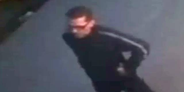 In this image from a surveillance video provided by the New York Police Department, a suspect is seen walking near a New York sports bar, Saturday, April 11, 2015. The suspect walked into the basement bathroom of the Turnmill Bar on East 27th Street on Saturday and hid inside a stall, police said. He  allegedly then grabbed the 23-year-old woman, pulled her into a stall and raped her. (New York Police Department via AP)