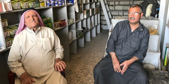 Omar Ibrahim and his son Yousif struggling to rebuild their lives after the ISIS occupation