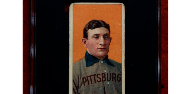 Rare 1909 Honus Wagner baseball card, one of the most sought-after sports collectibles in the world, in a protective casein Sunset Hills, Mo. A New Jersey man, whose name has not been released, was the winning bidder for the rare baseball card at $1.2 million.