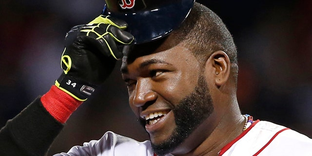 Aug. 20, 201: Boston Red Sox designated hitter David Ortiz tips his cap while standing on third base during a baseball game.