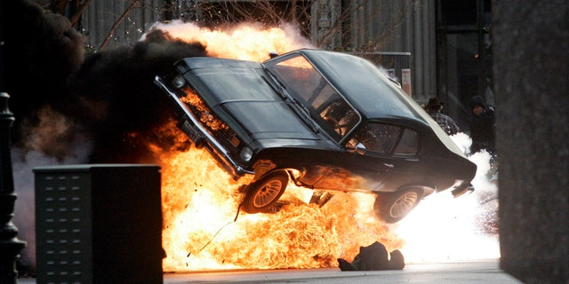 """A car blows up on the set of """"Red Dawn"""" in Detroit, Michigan, October 19, 2009. (REUTERS/Rebecca Cook)"""