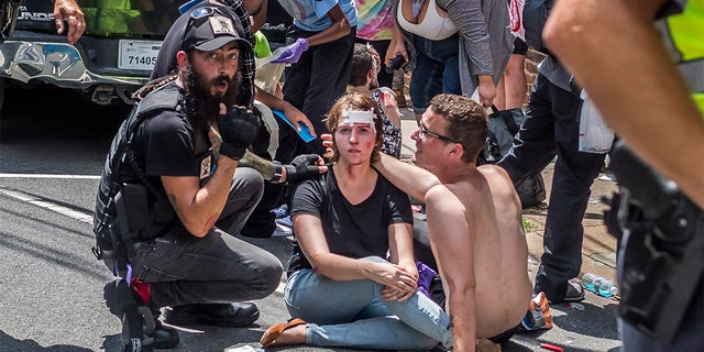 """""""I don't think it's ludicrous that if white supremacists are carrying guns that anti-fascists might want to carry guns, too,"""" Mark Bray, a visiting Dartmouth professor"""