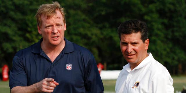 """FILE - In this Aug. 4, 2010, file photo, NFL Commissioner RogerGoodell, left, talks with Washington Redskins owner Daniel Snyder, right, after the team's NFL football training camp at Redskins Park in Ashburn, Va. In a statement released Saturday, Sept. 13, 2014, Snyder says he supports Goodell, stating he """"has always had the best interests of football at heart"""" and """"we are fortunate to have him."""" (AP Photo/Rob Carr, File)"""