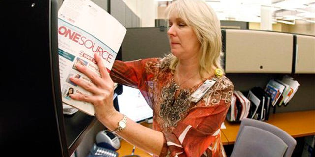 "Jennie Taylor, a marking coordinator at LifeWay Christian Resources, works in her office on Wednesday, Oct. 6, 2010, in Nashville, Tenn. Lifeway has a partnership with backgrounchecks.com to offer background screenings to Lifeway customers at discounted prices. Taylor said that many churches are now doing background checks on employees. ""If they're not doing it, they're considering it and looking for options and sources to do it,"" Taylor said."