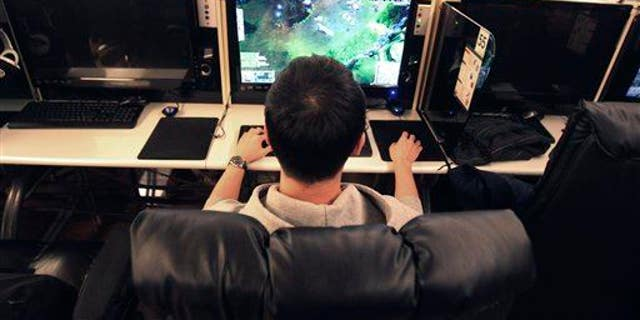 A college student plays online computer games at an Internet cafe in Seoul, South Korea.