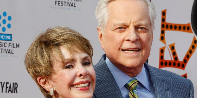"""Actress Barbara Rush (L) arrives with TCM host Robert Osborne at the world premiere of the 40th anniversary restoration of the film """"Cabaret"""" during the opening night gala of the 2012 TCM Classic Film Festival in Hollywood, California April 12, 2012."""