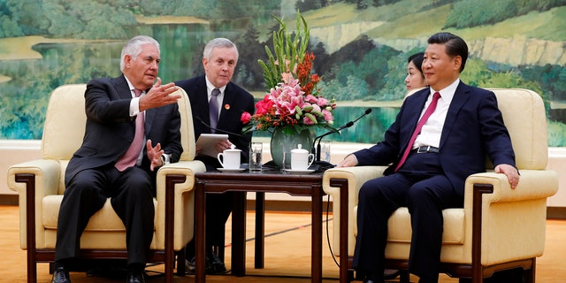 U.S. Secretary of State Rex Tillerson, left, chats with China's President Xi Jinping during a meeting at the Great Hall of the People in Beijing, Saturday, Sept. 30, 2017.
