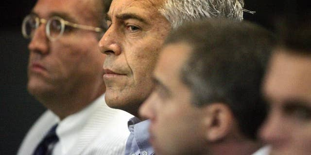 This July 30, 2008 photo shows Jeffrey Epstein in custody in West Palm Beach, Fla. Epstein was suspected nearly a decade ago of paying for sex with underage girls. The FBI abruptly dropped its investigation a few years ago, and Epstein pleaded guilty to a single state charge of soliciting prostitution. He served 13 months in jail. Now, two women who say they were sexually abused as girls by Epstein are hoping a trove of new documents will get the case reopened. (AP Photo/Palm Beach Post, Uma Sanghvi)