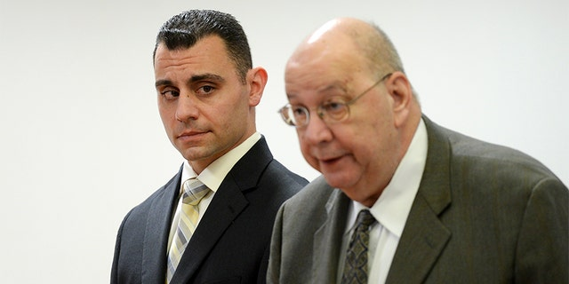 Richard Dabate, seen on the left in the file photo, was handed a wrongful death lawsuit by the sister of his deceased wife. Authorities accused Dabate of killing his wife in 2015 after finding holes in his alibi.