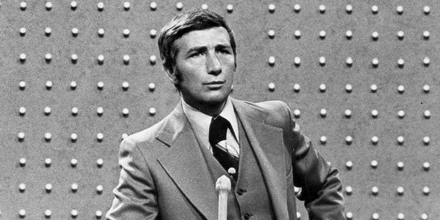 """This June 1978 file photo shows Richard Dawson, host of """"Family Feud"""" in character. Dawson, the wisecracking British entertainer who was among the schemers in the 1960s sitcom """"Hogan's Heroes"""" and a decade later began kissing thousands of female contestants as host of the game show """"Family Feud"""" died Saturday, June 2, 2012. He was 79."""