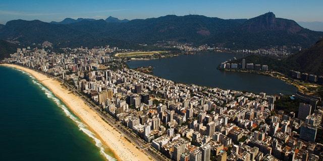 RIO DE JANEIRO, BRAZIL - NOVEMBER 12:  Aerial view of Rodrigo de Freitas Lagoon (Lagoa Rodrigo Freitas)  and Ipanema beach on November 12, 2013 in Rio de Janeiro, Brazil.  (Photo by Buda Mendes/Getty Images)
