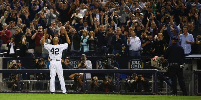 Mariano Rivera waves to the crowd on Sept. 26, 2013 at the Yankee Stadium.