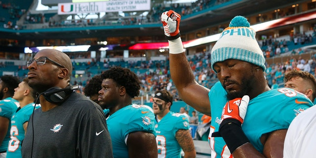 Miami Dolphins' player Robert Quinn raised his fist in the air in protest during the National Anthem this week.