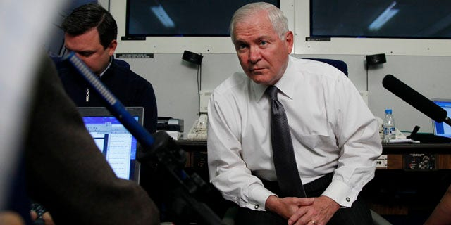 June 3: Defense Secretary Robert Gates pauses to listen to media questions aboard a U.S. Military aircraft en route to Singapore. (AP)