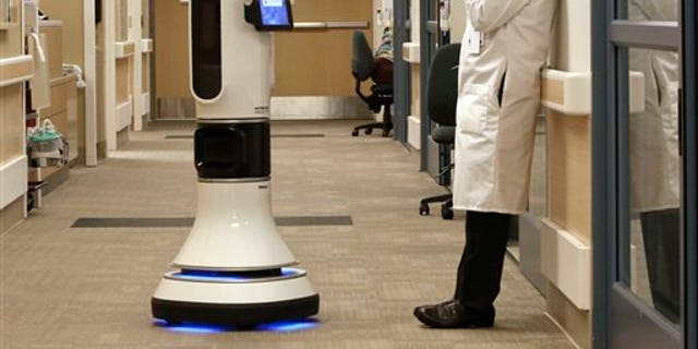 Industry leaders are looking to robots as the most efficient way for American factories to compete with cheap labor overseas.
