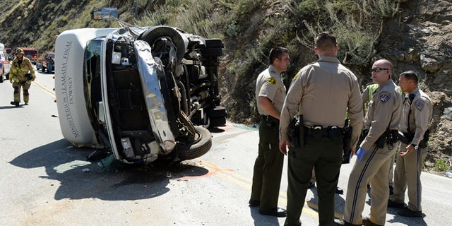 People were injured after a small tour bus crashed and rolled over on highway 330 approximately 2 miles north of the 210 freeway Sunday, May 22, 2016. Both directions of the 330 are currently closed. Cause of the crash is under investigation. (Will Lester /The Inland Valley Daily Bulletin via AP)  MANDATORY CREDIT
