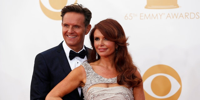 Producer Mark Burnett and wife, Roma Downey, arrive at the 65th Primetime Emmy Awards in Los Angeles September 22, 2013.