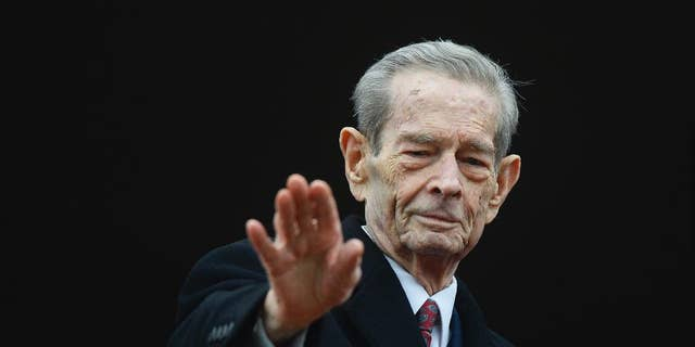 Romania's former King Michael I waves to supporters during an appearance at the Elisabeta Palace in Bucharest, Romania, Wednesday, Nov. 19, 2014. Former monarch King Michael, 93, the only surviving leader from World War II, invited President-elect Klaus Iohannis to lunch Wednesday at his Elizabeth Palace.(AP Photo/Octav Ganea, Mediafax) ROMANIA OUT