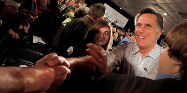 Republican presidential candidate, former Massachusetts Gov. Mitt Romney greets the crowd during a campaign stop Saturday, March 17, 2012, in Collinsville, Ill. (AP Photo/Charlie Riedel)