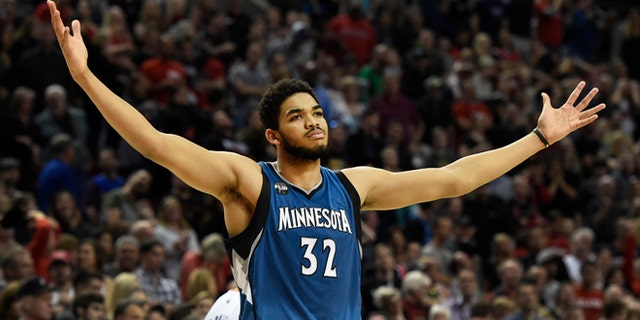 Karl-Anthony Towns helped the Mayo Clinic get more test kits. (AP Photo/Steve Dykes, File)