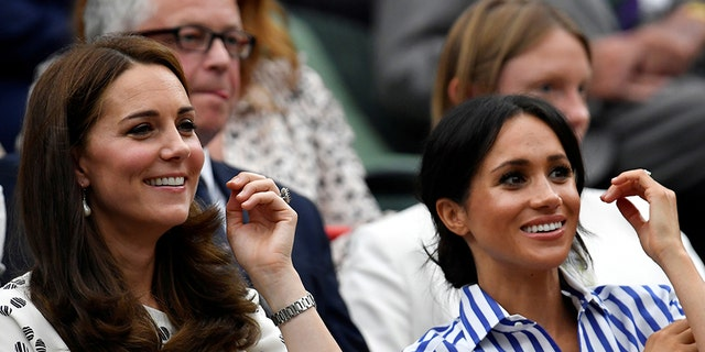 Kate, Duchess of Cambridge, left, and Meghan, Duchess of Sussex, right, take in the sights at Wimbledon.